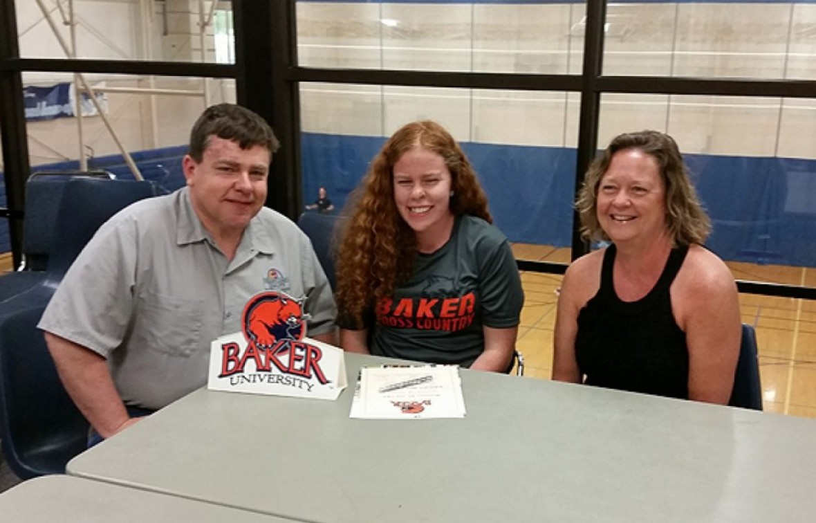Bailey Hollander signs her letter of intent with her parents Becky and Jim Hollander