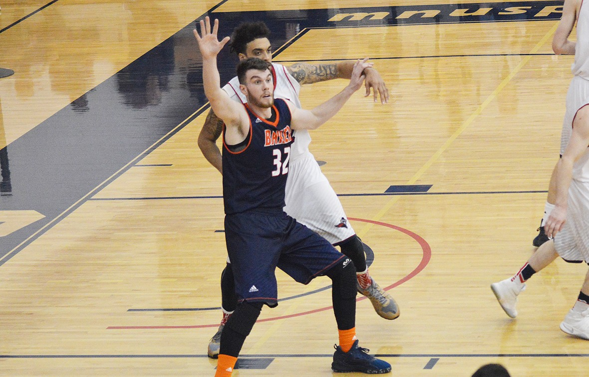 baker university - men's basketball opens season with win over